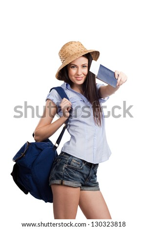 Portrait of happy tourist woman holding passport on holiday isolated on white background - stock photo