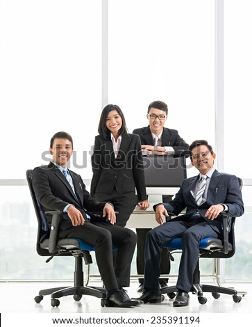Portrait of happy Vietnamese business team