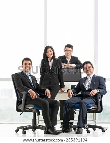 Portrait of happy Vietnamese business team - stock photo