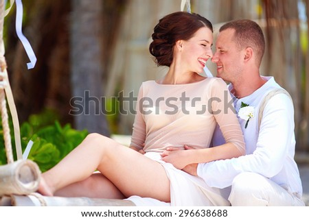 portrait of happy wedding couple on tropical beach - stock photo