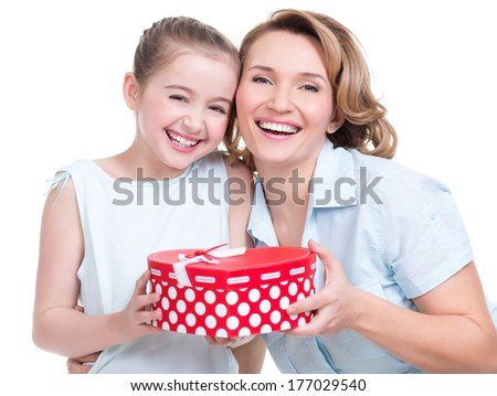 Portrait of happy  white mother and young daughter hold present - isolated. Happy family people concept.
