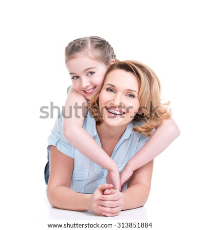 Portrait of happy white mother and young daughter lying on the floor- isolated. Happy family people concept.