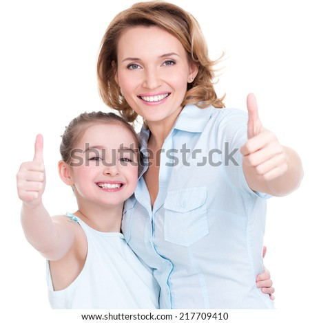 Portrait of happy  white mother and young daughter with thumbs up - isolated. Happy family people concept. - stock photo