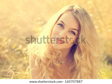 Portrait of Happy Woman at Summer Field