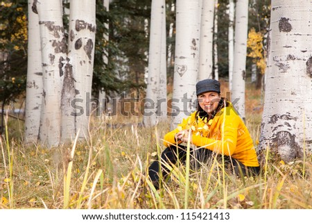 Portrait of Happy Woman in Autumn Forest