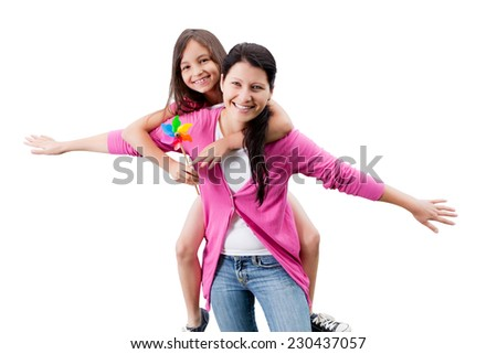 Portrait of happy woman piggybacking daughter against white background