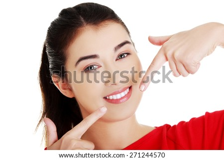 Portrait of happy woman showing her teeth. - stock photo