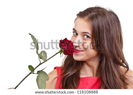 Portrait of happy woman smelling red rose - stock photo