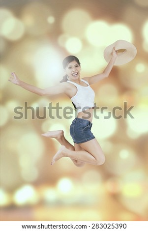 Portrait of happy woman with casual clothes, jumping with blur background - stock photo