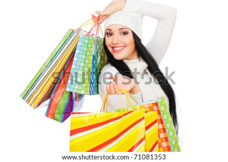 portrait of happy woman with shopping bags