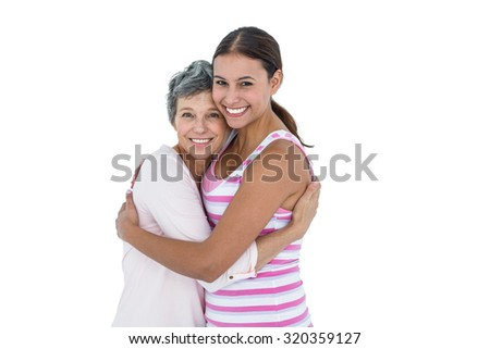 Portrait of happy women hugging against white background
