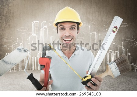 Portrait of happy worker holding various equipment against hand drawn city plan - stock photo