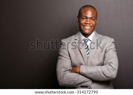 portrait of happy young afro american business man looking at the camera - stock photo