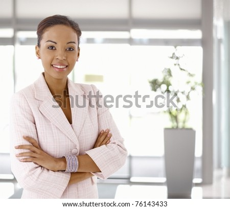 Portrait of happy young afro-american woman, looking at camera, smiling.? - stock photo