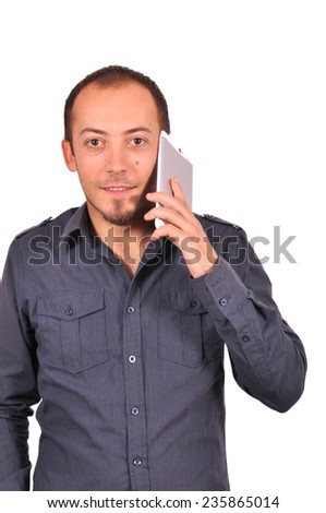Portrait of happy young attractive man calling by mobile - stock photo