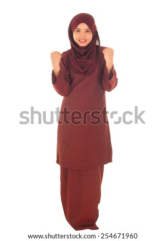 Portrait of happy young beautiful asian muslim woman with wearing hijab - stock photo
