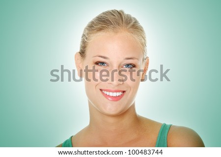 Portrait of happy young blond woman - stock photo