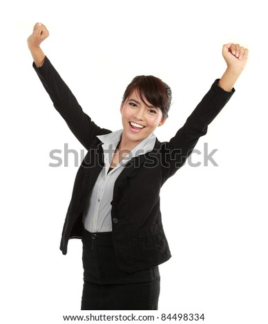 Portrait of happy young business woman celebrating success - stock photo