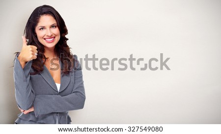 Portrait of happy young business woman over blue background. - stock photo