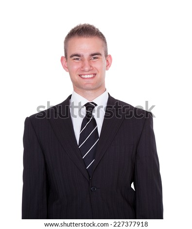 Portrait of happy young businessman standing against white background