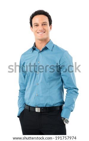 Portrait Of Happy Young Businessman With Hands In Pocket Looking At Camera Isolated On White Background - stock photo