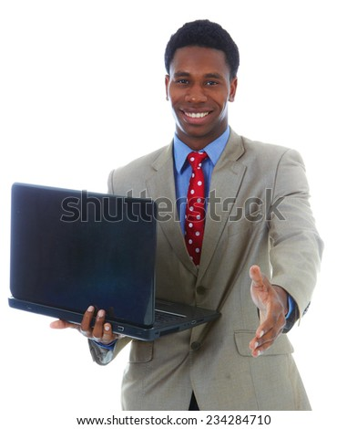 Portrait of happy young businessman with laptop offering handshake over white background
