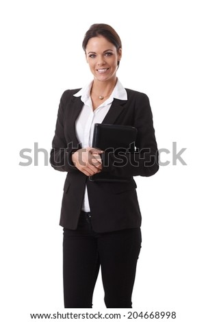 Portrait of happy young businesswoman in black suit, smiling, looking at camera, holding organizer.