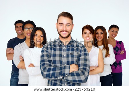 Portrait of happy young casual people with arms folded over white background - stock photo