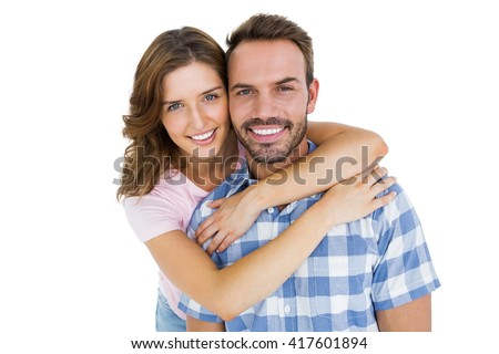Portrait of happy young couple embracing on white background - stock photo