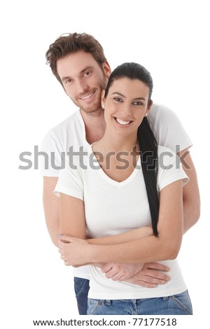 Portrait of happy young couple, hugging, smiling.? - stock photo