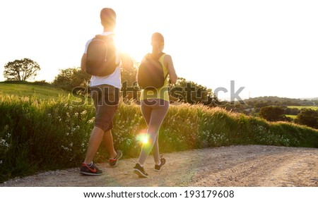 Portrait of Happy Young couple on the field in spring - stock photo