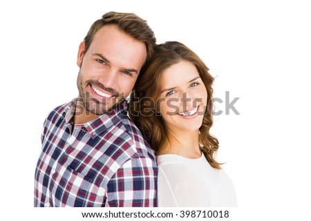 Portrait of happy young couple standing back to back on white back ground - stock photo