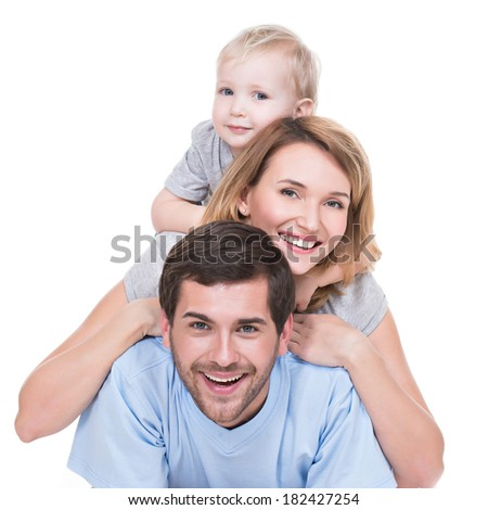 Portrait of happy young family with children lying on the floor - isolated on white background.