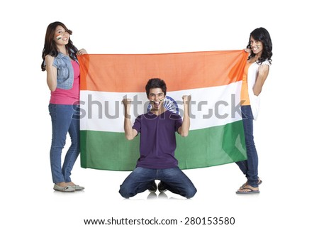 Portrait of happy young friends in casuals with Indian flag cheering over white background - stock photo
