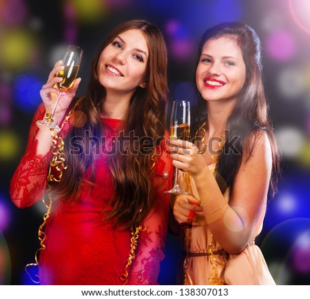 Portrait of happy young friends with cocktails