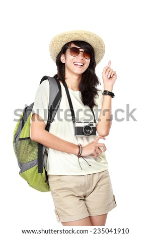 portrait of happy young girl bring backpack pointing up