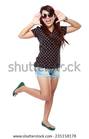 Portrait of  happy young girl gesturing while isolated on white - stock photo
