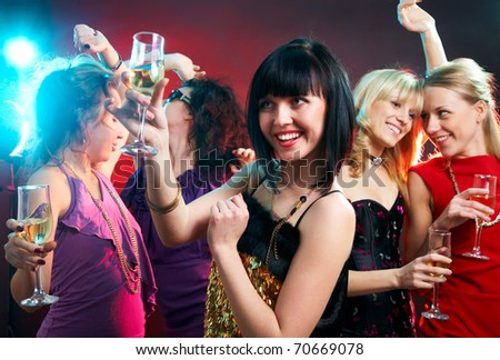 Portrait of happy young girls  on the party