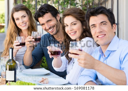 Portrait Of Happy Young Group Friends Holding Wine Glass Outdoor - stock photo