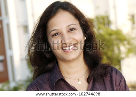 Portrait of happy young Indian woman