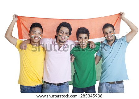 Portrait of happy young male friends standing together with Indian flag over white background - stock photo