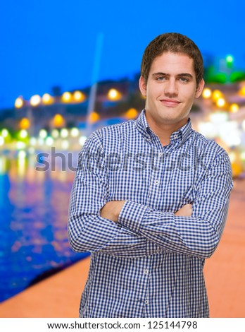 Portrait Of Happy Young Man at a port