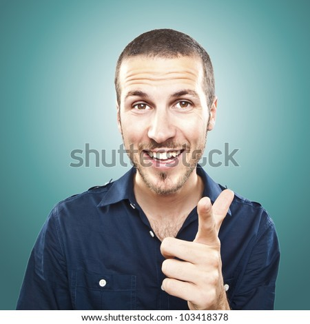 Portrait of happy young man pointing at you - stock photo