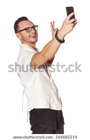 Portrait of happy young man taking self portrait with smartphone, isolated on white background - stock photo