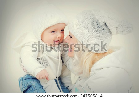 Portrait of happy young mother and cute little son - stock photo