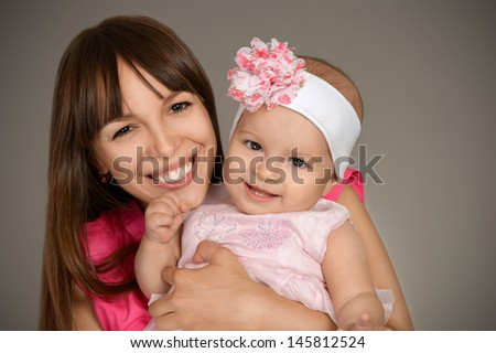 portrait of happy young mother with her cute little daughter - stock photo