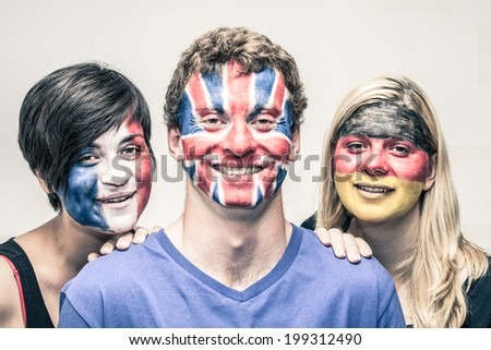 Portrait of happy young people with painted European flags on their faces. - stock photo
