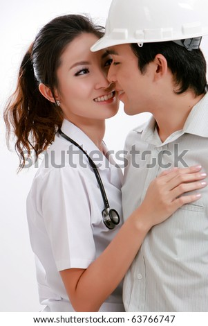 Portrait of happy young Physician lay  and engineer  smiling together - stock photo