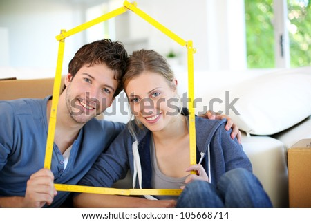Portrait of happy young property owners - stock photo