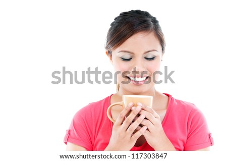 Portrait of happy young woman holding a cup over white background